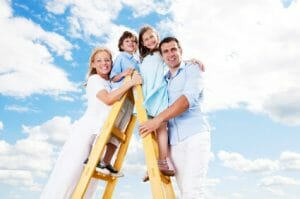 Cheerful family standing on the ladder.