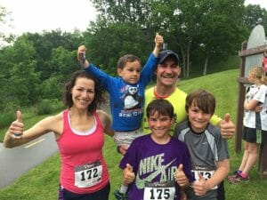 Amy's family competing in a local running race together